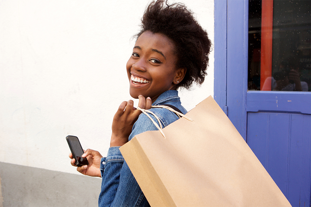 Woman walking, on phone, and shopping